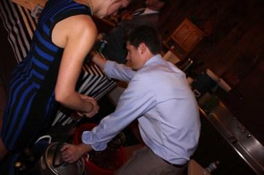 Ryan helping start the keg, ha